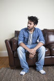 Indian man relaxing at home. Royalty Free Stock Image