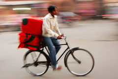 Indian man riding bike, blurred motion, Sadar Market, Jodhpur, Royalty Free Stock Photography