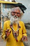 Indian man (sadhu) are praying at Diwali festival Stock Photos