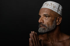 Indian Man Saying Prayers Royalty Free Stock Photography