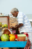 Indian man selling fruits at beach market Royalty Free Stock Images