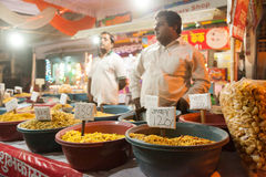 Indian man selling snacks at market Royalty Free Stock Photo