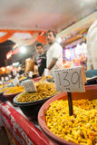 Indian man selling snacks at market Royalty Free Stock Photography