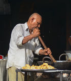 Indian man selling street foods in Delhi Royalty Free Stock Photo