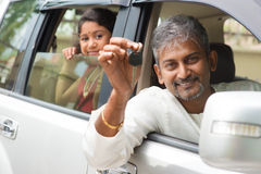 Indian man showing his new car key. Indian men buying new car and showing the key, sitting in car. Asian family lifestyle royalty free stock image