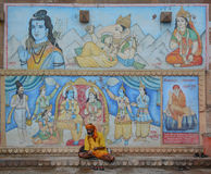Indian man sitting at the ghat in Varanasi Royalty Free Stock Images