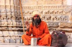 Indian man sitting at Jagdish temple, Udaipur, India Stock Photos