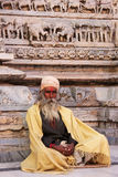 Indian man sitting at Jagdish temple, Udaipur, India Stock Image