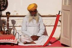 Indian man sitting at Mehrangarh Fort, Jodhpur, India Stock Photo