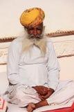Indian man sitting at Mehrangarh Fort, Jodhpur, India Royalty Free Stock Photography