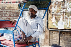Indian man sitting in rickshaw cab Royalty Free Stock Photos