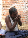 Indian man smoking Royalty Free Stock Photos