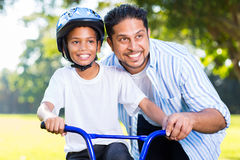 Indian man son bike Stock Image