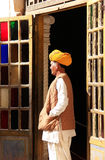 Indian man standing by the doorway at Mehrangarh Fort, Jodhpur, Royalty Free Stock Photography