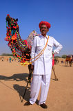 Indian man standing with his decorated camel at Desert Festival, Royalty Free Stock Photos