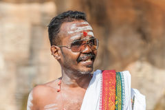 Indian man in sunglasses with face painting Royalty Free Stock Photo