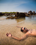 Indian Man Swimming At Ocean Beach Royalty Free Stock Photos
