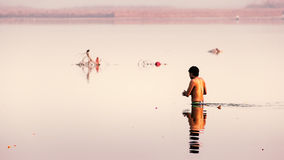 An Indian man taking holy dip in The Ganga river Royalty Free Stock Images