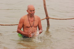 Indian man taking holy dip in river Ganga Royalty Free Stock Images