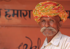 Indian Man. TORDI GARH, INDIA, MARCH 1: An unidentified man inside the village of Tordi Garh, Rajasthan, Northern India on March 1, 2012. The fort and palace are Stock Photo