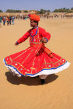 Indian man in traditional dress dancing at Desert Festival, Jais Stock Photography