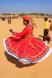 Indian man in traditional dress dancing at Desert Festival, Jais Stock Photos
