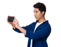Indian man using cellphone for taking photo. Isolated on white background Stock Photography
