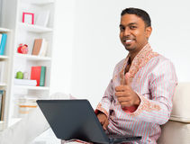 Indian man using computer at home. Royalty Free Stock Photos