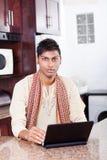 Indian man using laptop Royalty Free Stock Image