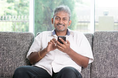 Indian man using smart phone Royalty Free Stock Images