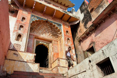 Indian man walk past old colorful temple gate Royalty Free Stock Photography