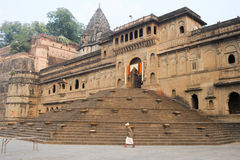 Indian man walking in front of Maheshwar palace on India Royalty Free Stock Photography