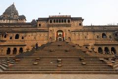 Indian man walking in front of Maheshwar palace on India Stock Photo