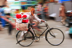 Indian man walking with his bike, blurred, motion, Sadar Market, Royalty Free Stock Photos