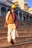 Indian man walking near holy lake, Pushkar, India Stock Images