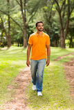 Indian man walking park. Casual young indian man walking in the park and looking away Stock Photography