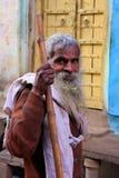 Indian man walking in the street of Pushkar, India Stock Image