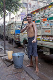 Indian man is washing himself, Kolkata, India Royalty Free Stock Image