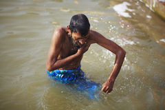 Indian man washing ritual in the river Ganges Royalty Free Stock Image