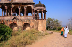 Indian man and woman walking along old temple, Ranthambore Fort, Royalty Free Stock Photos