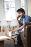 Indian man working on a laptop Royalty Free Stock Images