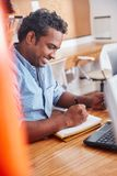 Indian man working in office. And taking notes for planning Royalty Free Stock Images