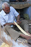 Indian man working with wood in the street, Bundi, India Royalty Free Stock Photography