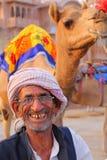 Indian mand standing with camel at Man Sagar Lake in Jaipur, Ind Stock Photo