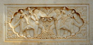 Indian marble carving. Marble carving of two elephants on a Maharajah's monument in Jaisalmer, India Stock Photo