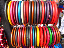 Indian Market-Bangles. Collection of colorful bangles hanged on metal rod for sale Royalty Free Stock Photography