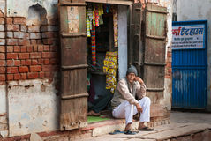 Indian market vendor in local street shop Royalty Free Stock Photo