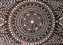 Indian marquetry panel with circular and floral pattern, part of a table. Souvenir shop in Kolkata, India Stock Image
