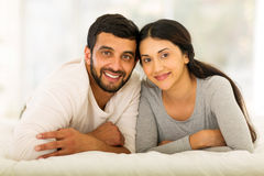 Indian married couple. Beautiful young indian married couple lying on bed Stock Photography