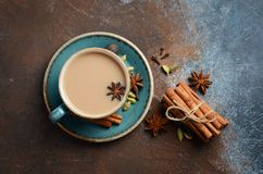 Indian masala chai tea. Spiced tea with milk on dark rusty background. Top view, copy space Stock Images